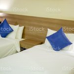 Twin Bed Room With Duvets Pillows And Bed Sheets Stock Photo Download Image Now Istock