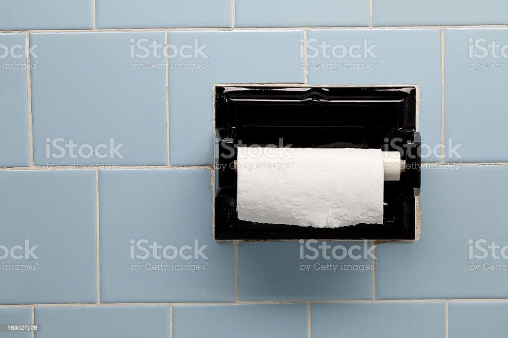 https www istockphoto com photo vintage blue bathroom tile toilet paper holder gm183527228 14857321