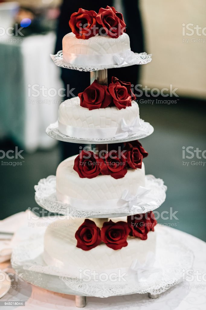 Wedding Cake With Red Roses Stock Photo   More Pictures of Bakery     wedding cake with red roses royalty free stock photo