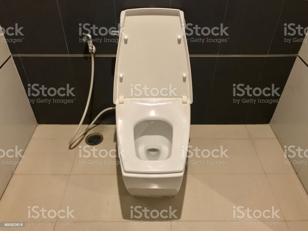 white ceramic toilet bowl with faucet stock photo download image now istock