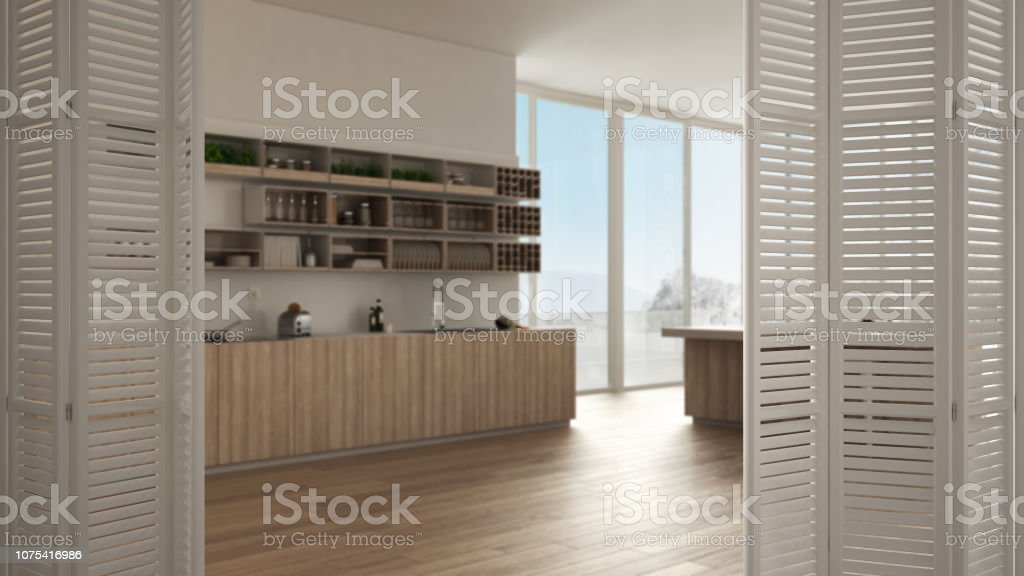 https www istockphoto com fr photo blanc porte pliante ouverture sur cuisine minimaliste avec armoires et de l c3 aele gm1075416986 287914828
