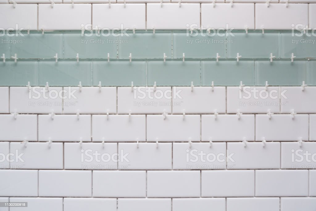 white subway tile green accent tile with spacers without grout stock photo download image now istock
