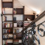 Wooden Bookshelf With Books Near Staircase In Attic Apartment Stock Photo Download Image Now Istock
