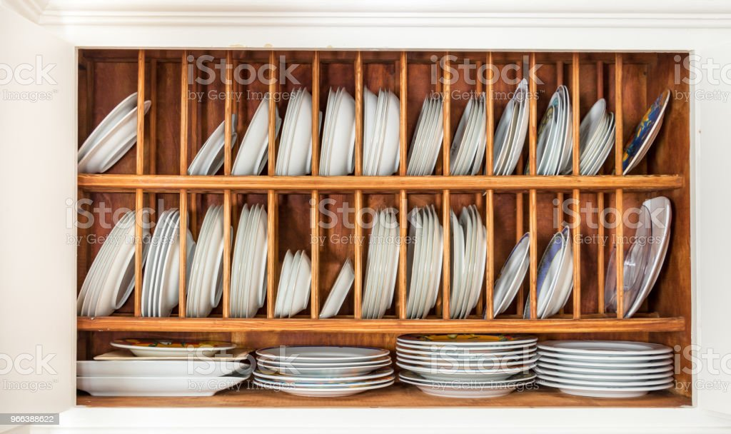 wooden plate rack inside a vintage cupboard stock photo download image now istock