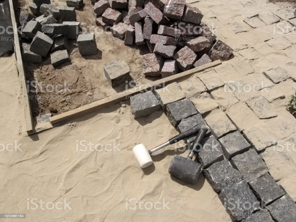 https www istockphoto com photo workplace for laying granite paving stones top view gm1012091154 272665088