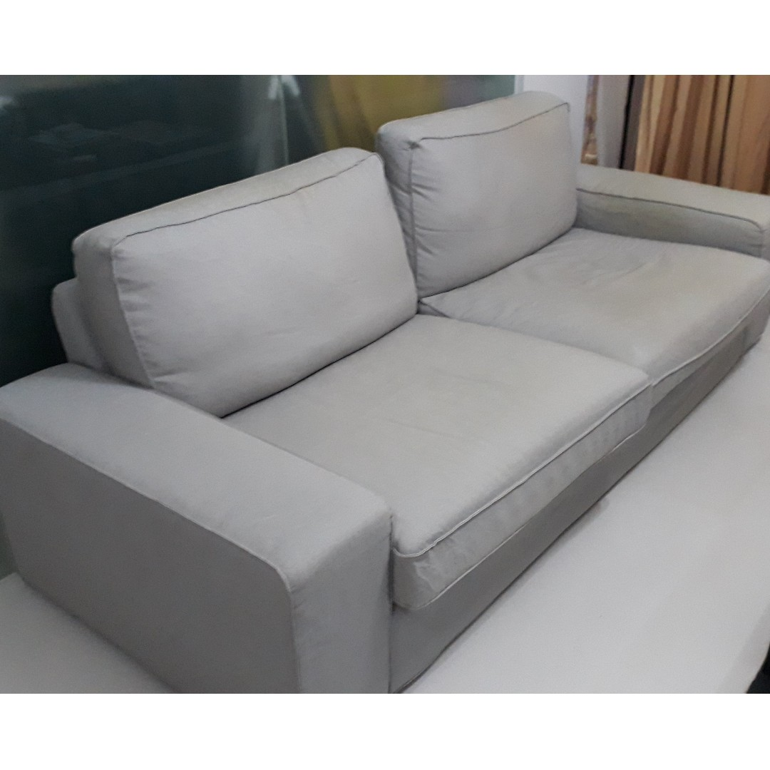 light grey cloth sofa three person