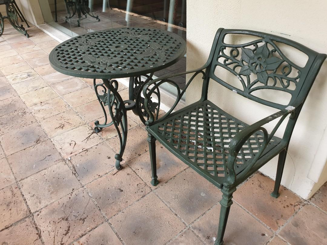 green wrought iron table chair set