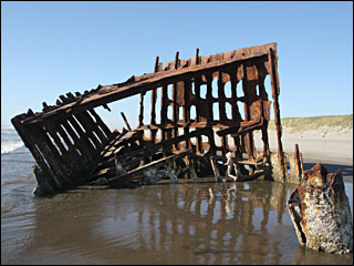 Shipwrecks emerge from sand along Oregon Coast