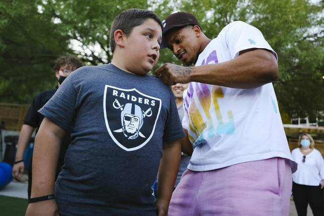 Big Brothers Big Sisters Shoes Giveaway with Raiders Johnathan Abram