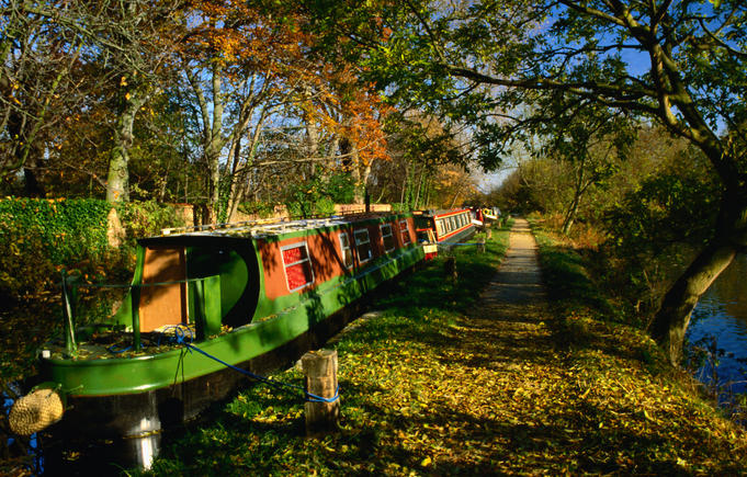 Longboats or barges moored along the canals of Oxford