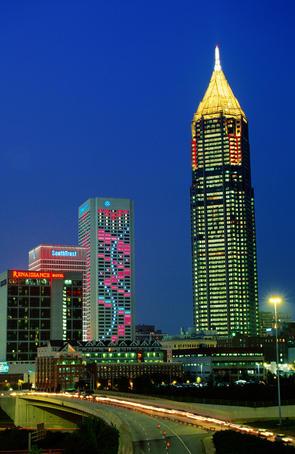 Illuminated city buildings.