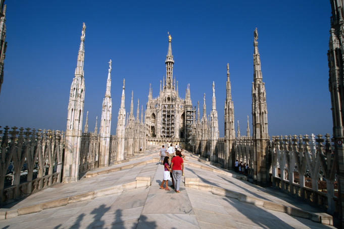 Tourists viewing spires on roof of Duomo.