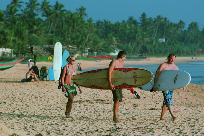 Surfers on main beach, heading out.