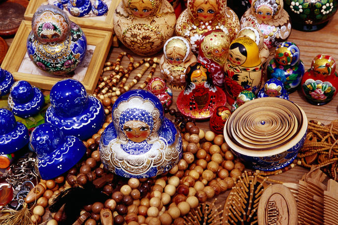 Matryoskha dolls & wooden beads for sale at souvenir market on waterfront in Listvyanka village on Lake Baikal.