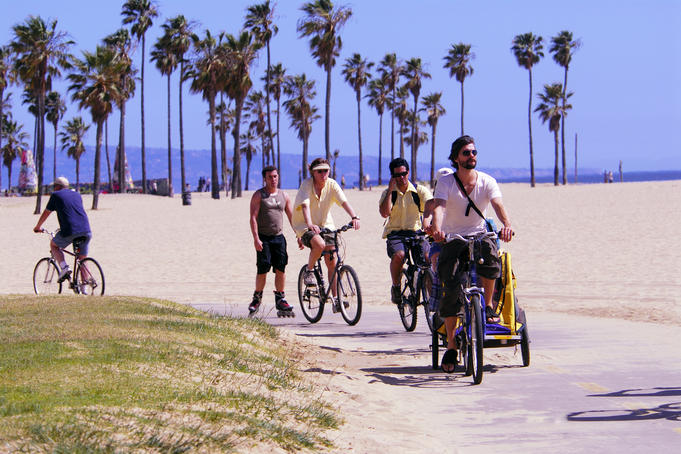 Cyclists and in-line skaters at Venice Beach.