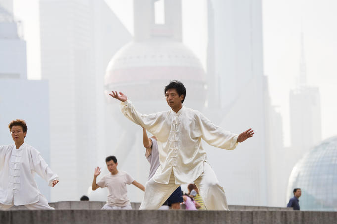 Performing tai chi on the Bund.