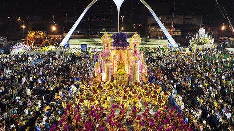 Beija Flor Samba School float during Carnival parade at the Sambodrome. The bird-shaped Sambodrome icon determines where the parade ends.