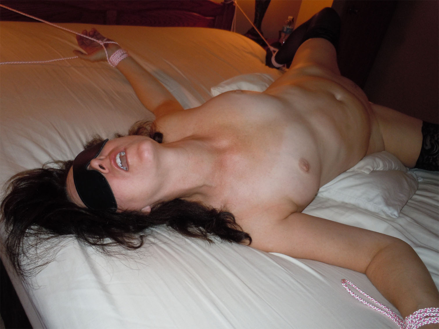 With you wife blindfolded and stripped