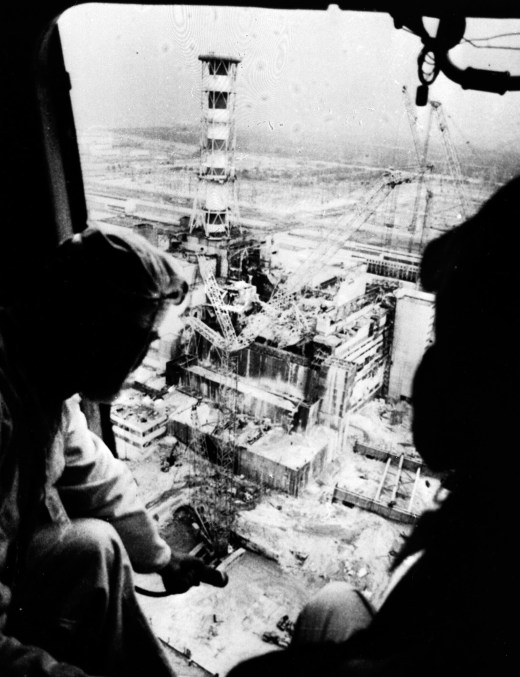 The destroyed Reactor No. 4 of the Chernobyl nuclear power plant after the explosion and fire on April 26, 1986, as seen from the open door of a helicopter. // Igor Kostin / AP
