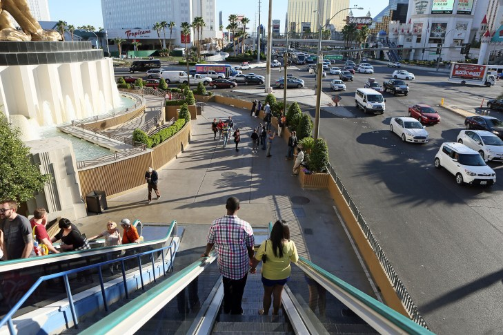 People ride down the escalator near the intersection of Las Vegas Boulevard and Tropicana Avenue on the Strip on Feb. 25, 2016, in Las Vegas, Nev. // Ronda Churchill / McClatchy