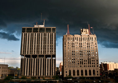 Storm clouds pass over downtown Flint