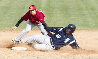 Image result for a picture of a baseball playing sliding into a base