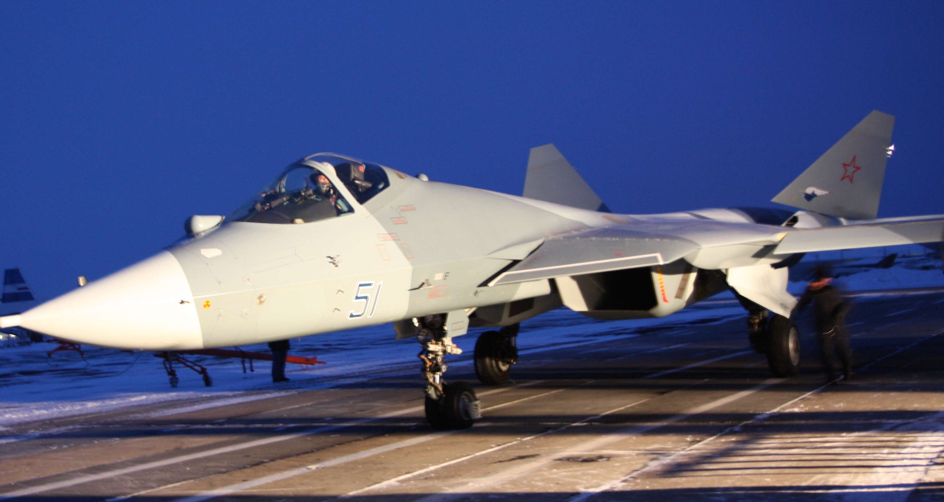 Prototype T-50 fighter with outboard container 14