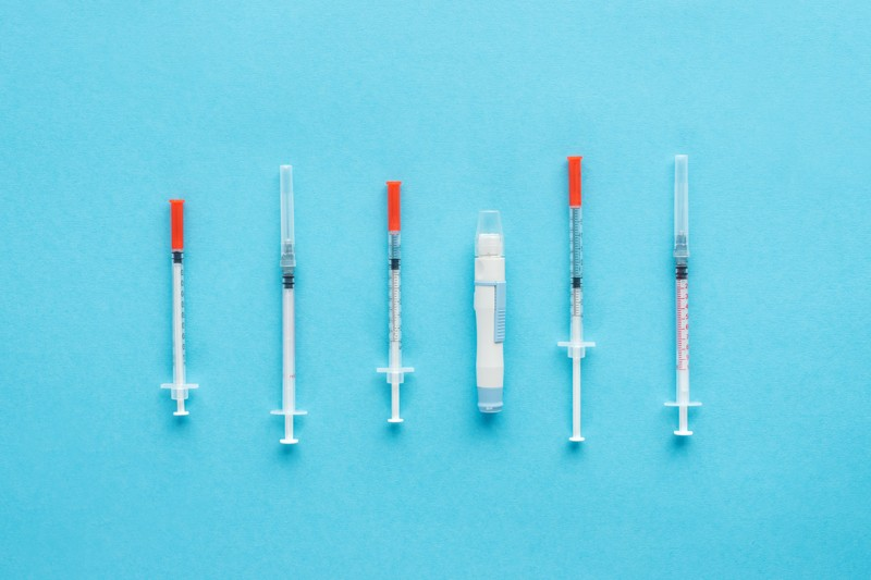 Insulin syringes for diabetes on blue background