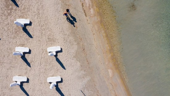 A drone photo shows an aerial view of sunbeds placed in accordance with the social distancing rules in Izmir, Turkey.