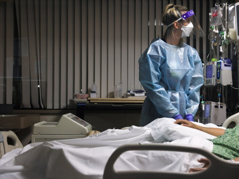 Tricia Cook cares for a COVID-19 patient in the Intensive Care Unit (ICU), California.