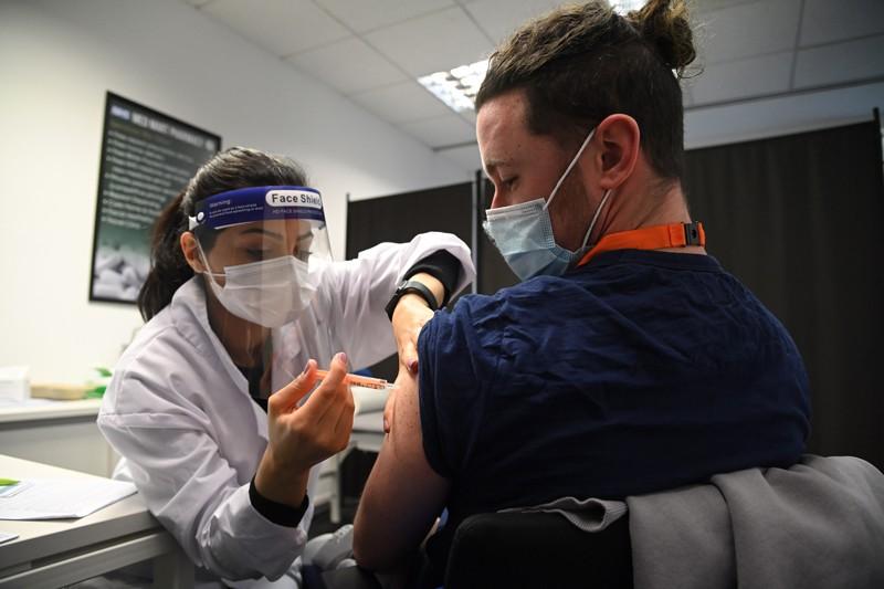 A care worker receives the Oxford-AstraZeneca Covid-19 vaccine