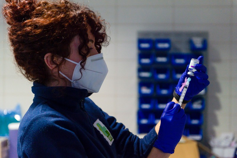 A healthcare worker prepares a syringe with the Astra Zeneca vaccine