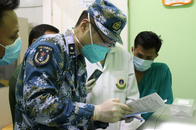 A member of a Chinese military medical team works at a laboratory for testing COVID-19