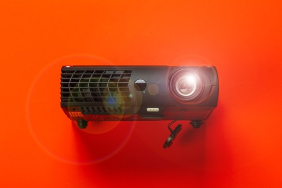Projector on red background