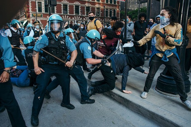 Protesters clash with police in Chicago , on May 30, 2020 during a protest against the death of George Floyd.
