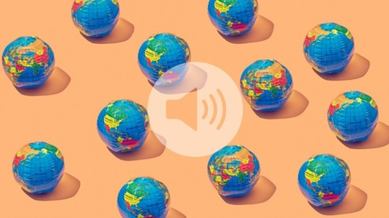 A group of earth globes laid in a pattern on an orange background