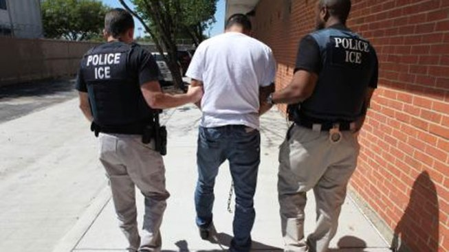 Image result for ice agents arresting Illegal