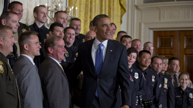 President Barack Obama stands for a photo with 2013 National Association of Police Organizations (NAPO) TOP COPS award winners during a ceremony in East Room of the White House on May 11.