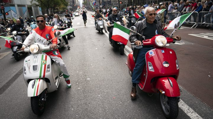 Motorists riding scooters with Italian flags roll up Fifth Avenue during the Columbus Day parade, Monday, Oct. 11, 2021, in the Manhattan borough of New York