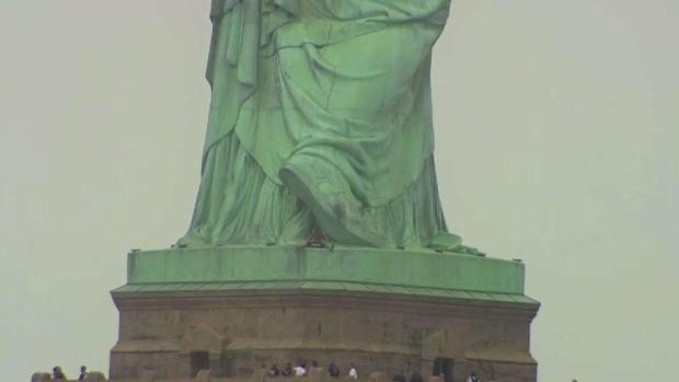 Woman Tries to Climb Statue of Liberty