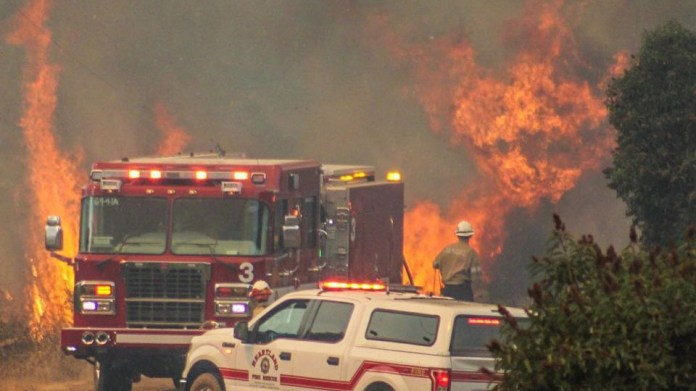 Lakeside firefighters fight Valley Fire.