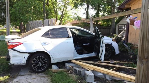 Car crashes through fence on Westside