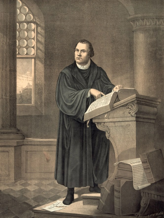 Engraving of Martin Luther pointing at a large book
