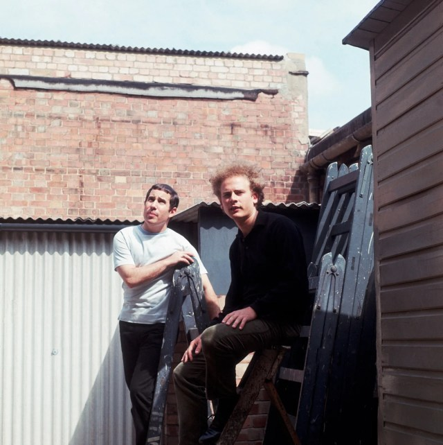 Paul Simon and Art Garfunkel standing outdoors circa 1965.