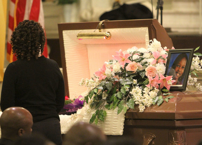 mourner pays respects to Ivyn Ogendi at her funeral at St. Patrick's church in Jersey City on November 14, 2010. Michael T. Dempsey / The Jersey Journal