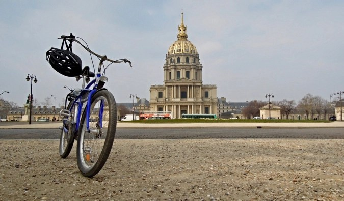 A single Fat Tire Tour bicycle parked on the sidewalk in Paris, France