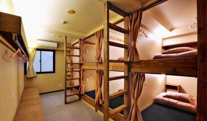 A charming bunkbeds of Khaosan Tokyo Origami hostel in Tokyo, Japan