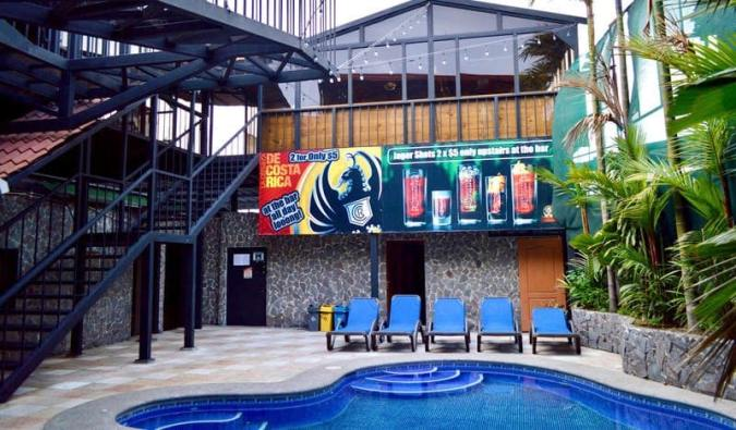 The pool and outdoor common area at Hostel Pangea in San José, Costa Rica