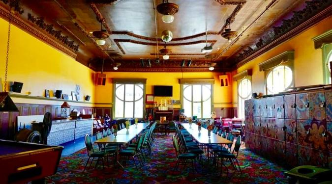 The huge ballroom dining area at the Green Tortoise Hostel in San Francisco, USA