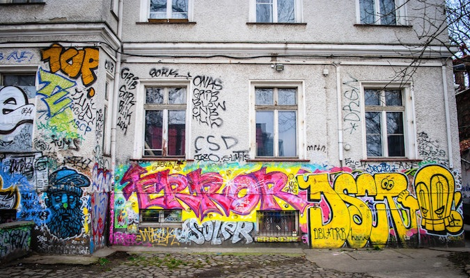 Beautiful graffiti on the walls of a dangerous street for solo travelers